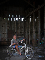 People in the old and disused railway yards in Battambang, Cambodia This old man lost his leg due to the mines in Cambodia