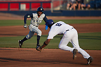 Tyler Tolbert (2) of the Columbia Fireflies hustles towards third base against the Kannapolis Cannon Ballers at Atrium Health Ballpark on May 21, 2021 in Kannapolis, North Carolina. (Brian Westerholt/Four Seam Images)