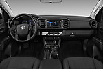 Stock photo of straight dashboard view of a 2018 Toyota Tacoma SR Access Cab 4x2 4-Cyl Auto Long Bed 4 Door Pick Up