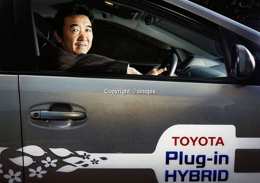 Yutaka Matsumoto, project general manager of Toyota Motor Corp.'s Strategy Planning Dept.'s R&D management center, sits behind the wheel of one of the automaker's plug-in hybrid vehicles at the company's headquarters in Tokyo, Japan on Tuesday 11 March 2009.