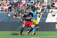 FOXBOROUGH, MA - AUGUST 8: Matt Polster #8 of New England Revolution scores during a game between Philadelphia Union and New England Revolution at Gillette Stadium on August 8, 2021 in Foxborough, Massachusetts.