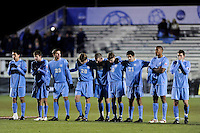North Carolina Tar Heals players stand arm in arm during the penalty kick shootout. The Akron Zips defeated the North Carolina Tar Heals 5-4 in penalty kicks after playing a scoreless game during the second semi-final match of the 2009 NCAA Men's College Cup at WakeMed Soccer Park in Cary, NC on December 11, 2009.