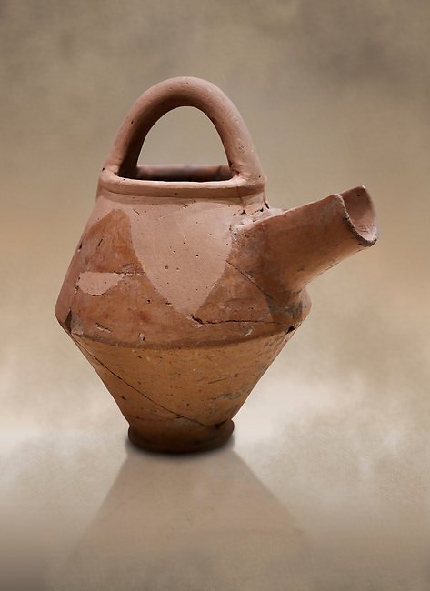 Hittite terra cotta side spout with stainer basket handles pitcher . Hittite Period, 1600 - 1200 BC.  Hattusa Boğazkale. Çorum Archaeological Museum, Corum, Turkey. Against a warm art bacground.