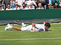 London, England, 27 june, 2016, Tennis, Wimbledon, Robin Haase (NED) slips on the grass and falls in his match against Diego Swartzman (ARG) <br /> Photo: Henk Koster/tennisimages.com