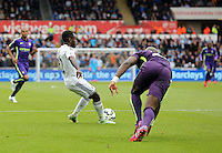 SWANSEA, WALES - MAY 17: Nathan Dyer of Swansea (L) takes a shot but fails to score during the Premier League match between Swansea City and Manchester City at The Liberty Stadium on May 17, 2015 in Swansea, Wales. (photo by Athena Pictures/Getty Images)