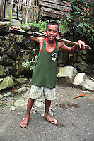 A boy poses with an air rifle that natives use to hunt wildlife with, more for food than for sport, in the vast rain forests of the Philippine Cordillera in the northeastern part of main island of Luzon in the Philippines. Mallibcong, Abra. August, 1999