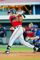 Edison Sanchez #37 of the Danville Braves follows through on his swing against the Burlington Royals at Burlington Athletic Park on August 14, 2011 in Burlington, North Carolina.  The Braves defeated the Royals 10-2 in a game called by rain in the bottom of the 8th inning.   (Brian Westerholt / Four Seam Images)