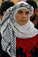 """Gaza.15.05.2008.A Palestinian girl dressed in traditional Bedouin clothes attends a ceremony marking the 'Nakba' (Catastrophe) in Gaza City on May 15, 2008. Palestinians protested across the occupied territories on the 60th anniversary of the 'catastrophe' of the birth of Israel today as the Jewish state's army went on high alert """"photo by Fady Adwan"""""""
