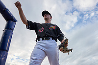 Batavia Muckdogs Troy Johnston (27) fist bumps fans during a NY-Penn League game against the State College Spikes on July 2, 2019 at Dwyer Stadium in Batavia, New York.  Batavia defeated State College 1-0.  (Mike Janes/Four Seam Images)