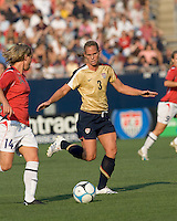 Woman of the match, Christie Rampone (United States, gold) prepares to defend. The United States defeated Norway, 1-0, in Rentschler Stadium, July 14, 2007.