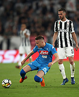 Calcio, Serie A: Juventus - Napoli, Torino, Allianz Stadium, 22 aprile, 2018.<br /> Napoli's Piotr Zielinski (l) in action dwith Juventus' Miralem Pjanic (r) during the Italian Serie A football match between Juventus and Napoli at Torino's Allianz stadium, April 22, 2018.<br /> UPDATE IMAGES PRESS/Isabella Bonotto