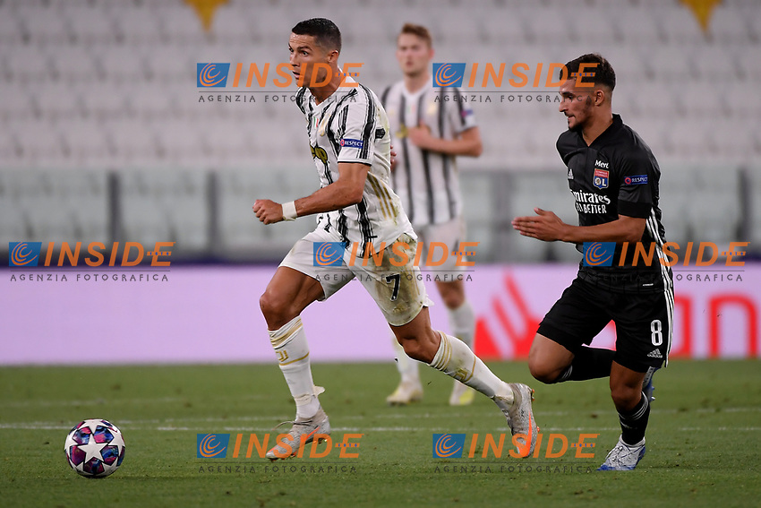 Cristiano Ronaldo of Juventus and Houssem Aouar of Lyon in action during the Champions League round of 16 second leg football match between Juventus FC and Lyon at Juventus stadium in Turin (Italy), August 7th, 2020. <br /> Photo Federico Tardito / Insidefoto