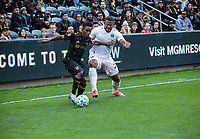 LOS ANGELES, CA - MARCH 01: Latif Blessing #7 of LAFC and Roman Torres #29 of Inter Miami CF battle for a ball in the corner during a game between Inter Miami CF and Los Angeles FC at Banc of California Stadium on March 01, 2020 in Los Angeles, California.