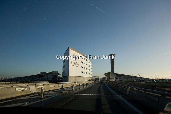 A photo taken of the Sheraton Hotel from the highway on approach to De Gaulle international airport in France.