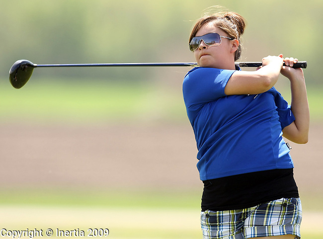 SIOUX FALLS, SD - MAY 18:  Shelby Ross of Red Cloud watches her tee shot on the 11th hole during the first round of the 2009 Class 'A' Girls Golf Tournament Monday at Central Valley in Hartford. (Photo by Dave Eggen/Inertia).
