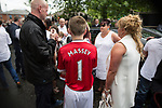 """© Joel Goodman - 07973 332324 . 28/08/2015 . Salford , UK . A boy wearing a Manchester United shirt with """" MASSEY 1 """" on the back , outside the church after the service . The funeral of Paul Massey at St Paul's CE Church in Salford . Massey , known as Salford's """" Mr Big """" , was shot dead at his home in Salford last month . Photo credit : Joel Goodman"""