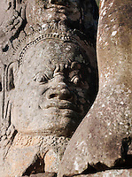Faces carved into the stone of the temples of Angkor, Siem Reap Province, Cambodia