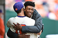 Starting pitcher Keyshawn Askew (46) of the Clemson Tigers hugs Kyle Wilkie after completing 5.1 innings in his first appearance in a game against the Charlotte 49ers on Monday, February 18, 2019, at Doug Kingsmore Stadium in Clemson, South Carolina. Clemson won, 7-6 and Askew recorded his first win as a Tiger. (Tom Priddy/Four Seam Images)