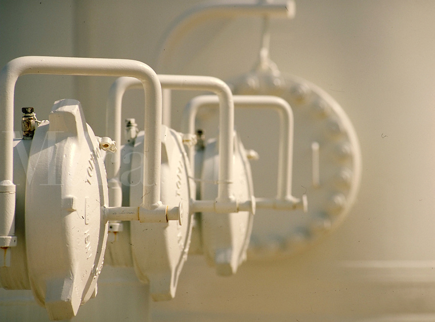 Detail of white equipment on the exterior of a power cogeneration plant. energy manufacture, production. Texas, rural southeast Texas.