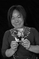 Mrs Hu holds a picture of her son Yang Yang,  who was stolen from under her nose, April 9th 2003. Mrs Hu is one of thousands of migrant mothers whose children have been stolen and sold to rich families desperate for a boy. Families are limited to a single child under the China's ruthless One Child Policy...PHOTO BY SINOPIX