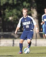 University of Rhode Island (URI) midfielder Brett Uttley (14) brings the ball forward. Boston College defeated University of Rhode Island, 4-2, at Newton Campus Field, September 25, 2012.