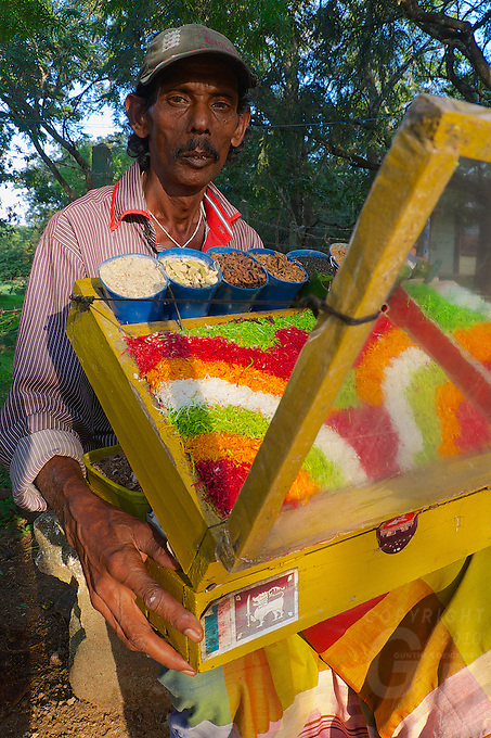 A local vendor selling some interestin and colorful snacks to the local tourists who visit the Polonnaruwa-Mediaeval Capital City in Sri Lanka