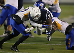 Nevada's Don Jackson (6) dives for extra yards against the San Jose State defense during the first half of an NCAA college football game in Reno, Nev., on Saturday, Nov. 16, 2013.<br /> (AP Photo/ Cathleen Allison).