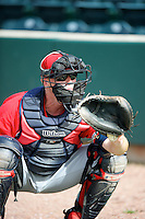 Mississippi Braves bullpen catcher Todd Baker catches a bullpen after a Southern League game against the Jacksonville Suns at the Baseball Grounds of Jacksonville on July 22, 2012 in Jacksonville, Florida.  Jacksonville defeated Mississippi 2-1.  (Mike Janes/Four Seam Images)