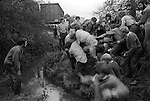 Bottle Kicking and Hare Pie Scrambling. Hallaton, Leicestershire 1973. Scoring a goal for Medbourne. Rodney Burns defending for Hallaton.