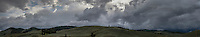 Extra wide panoramic of threatening clouds churning over the western approach to Monarch Pass, Colorado.
