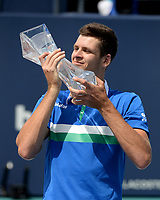 MIAMI GARDENS, FL - APRIL 04: Hubert Hurkacz poses with the championship trophy after defeating Jannik Sinner 7-6 (7-4) 6-4 during the Men's finals at the 2021Miami Open at Hard Rock Stadium on April 4, 2021 in Miami Gardens, Florida. Credit: mpi04/MediaPunch