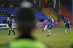 Stockport County 2 Rushden & Diamonds 2, 22/01/2006. Edgeley Park, League Two. Stockport County versus Rushden & Diamonds, Coca-Cola Football League Two at Edgeley Park, Stockport. With the teams occupying the bottom two places in the Football league, points were vital in home club's Jim Gannon's first game in charge as manager. The match ended 2-2. Picture shows a police officer keeps an eye on Danny Boshell taking a free-kick for County.<br />  Photo by Colin McPherson.