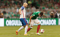 Mexico City, Mexico - Sunday June 11, 2017: Michael Bradley, Héctor Herrerao during a 2018 FIFA World Cup Qualifying Final Round match with both men's national teams of the United States (USA) and Mexico (MEX) playing to a 1-1 draw at Azteca Stadium.