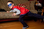 My older son, then five, chose to wear a mask and cape to a portrait shoot in our living room.