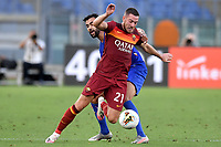 Rachid Ghezzal of ACF Fiorentina and Jordan Veretout of AS Roma compete for the ball during the Serie A football match between AS Roma and ACF Fiorentina at stadio Olimpico in Roma (Italy), July 26th, 2020. Play resumes behind closed doors following the outbreak of the coronavirus disease. <br /> Photo Antonietta Baldassarre / Insidefoto