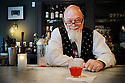 Paul Gustings, bartender at Broussard's, prepares a Sazerac during Happy Hour, New Orleans, Friday, July 25, 2014.