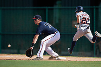 Atlanta Braves Austin Bush (59) picks a throw as Danny Woodrow (22) runs through the bag during an Instructional League game against the Detroit Tigers on October 10, 2017 at the ESPN Wide World of Sports Complex in Orlando, Florida.  (Mike Janes/Four Seam Images)