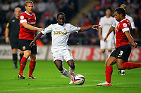 Pictured: Nathan Dyer (C) of Swansea against Scott Golbourne of Barnsley (R). Tuesday 28 August 2012<br /> Re: Capital One Cup game, Swansea City FC v Barnsley at the Liberty Stadium, south Wales.