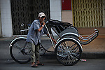 A cyclo driver gets ready for work on Bui Vien Street in Ho Chi Minh City, Vietnam. Aug. 18, 2011.