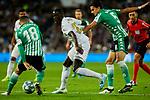 Ferland Mendy of Real Madrid and Andres Guardado (L) and Marc Bartra (R) of Real Betis Balompie during La Liga match between Real Madrid and Real Betis Balompie at Santiago Bernabeu Stadium in Madrid, Spain. November 02, 2019. (ALTERPHOTOS/A. Perez Meca)