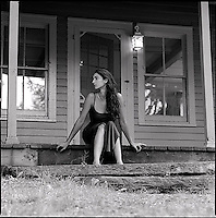 Woman sitting on front porch<br />