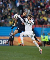 The USA's Oguchi Onyewu fights for a loose ball with Slovenia's Milivoje Novakovic Ellis Park Stadium in Johannesburg, South Africa on Friday, June 18, 2010.  The USA tied Slovenia 2-2.