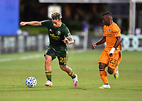 LAKE BUENA VISTA, FL - JULY 18: Pablo Bonilla #28 of the Portland Timbers dribbles away from Darwin Quintero during a game between Houston Dynamo and Portland Timbers at ESPN Wide World of Sports on July 18, 2020 in Lake Buena Vista, Florida.