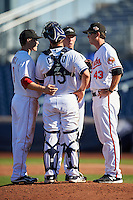 Peoria Javelinas pitching coach Justin Lord (43), of the Baltimore Orioles organization, talks with pitcher Evan Mitchell (16), infielder Zach Vincej (3), both of the Cincinnati Reds organization, and catcher Nick Ciuffo (13), of the Tampa Bay Rays organization, during a game against the Scottsdale Scorpions on October 22, 2016 at Peoria Stadium in Peoria, Arizona.  Peoria defeated Scottsdale 3-2.  (Mike Janes/Four Seam Images)