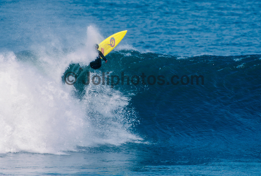 Wayne Lynch (AUS) surfing Mundaka river-mouth during an epic swell in November 1989. Mundaka, Basque Country, Spain. Photo: joliphotos.com
