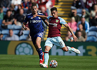 29th August 2021; Turf Moor, Burnley, Lancashire, England; Premier League football, Burnley versus Leeds United: Ashley Westwood of Burnley passes the ball under pressure from Kalvin Phillips of Leeds United