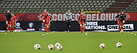 Belgian physiotherapist Jan Van Der Jeugt with Julie Biesmans (20) of Belgium and Tine De Caigny (6) of Belgium  and Sarah Wijnants (10) of Belgium  and Davina Philtjens (2) of Belgium  pictured during the warming up of a friendly female soccer game between the national teams of Belgium , called the Red Flames and The Netherlands , called the Oranje Leeuwinnen in a pre - bid tournament called Three Nations One Goal with the national teams from Belgium , The Netherlands and Germany towards a bid for the hosting of the 2027 FIFA Women's World Cup , on Thursday 18 th of February 2021  in Brussels , Belgium . PHOTO SPORTPIX.BE | SPP | DIRK VUYLSTEKE