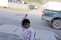 A Tibetan child plays in the streets of Zaduo, in the far interior of the Tibetan Plateau, in western China. Relocation communities been created to house nomadic herders moved from the highland grasslands. The nomads have been blamed for contributing to the deterioration of the grasslands, so have been moved, sometimes forcibly, into newly built towns that can be found across the plateau.