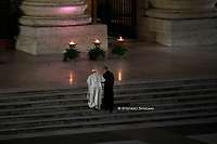 Pope Francis holds the cross as he leads the Way of the Cross in St. Peter's Square at the Vatican April 2, 2021