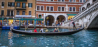 Fine, Art, Landscape Urban Photograph, of a Gondolier, on one of the romantic canals in Venice Italy.